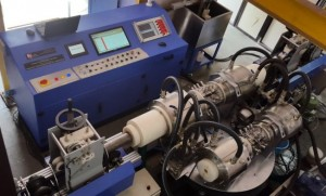Tube testing with dual rotation unit system